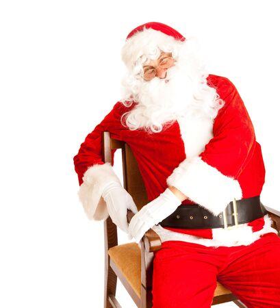 Santa Claus sitting in a chair photo