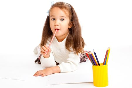 Preschool girl with pencil in mouth photo