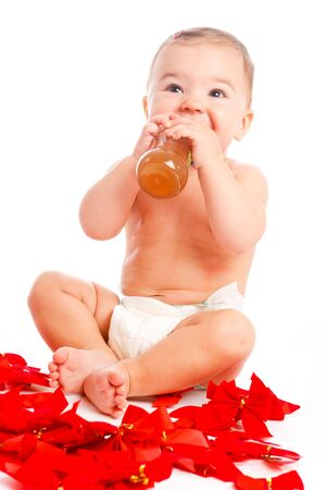 Lovely baby girl drinking, isolated photo