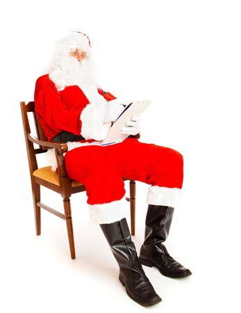 making notes: Santa Claus making notes in the wish list Stock Photo