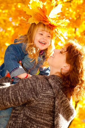 fall fun: Happy mother and daughter in the autumn park