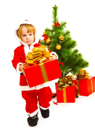 Baby in a red santa costume carrying a Christmas present photo