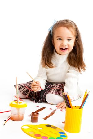 Preschool girl painting a picture photo