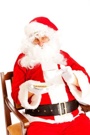Coffee time for Santa Claus, isolated, on white background photo