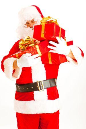 Santa Claus carrying present boxes photo