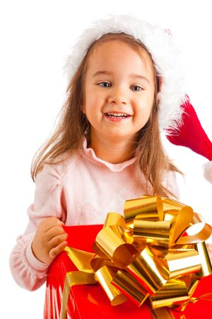 Lovely preschool girl carrying a large present box Stock Photo - 5705993