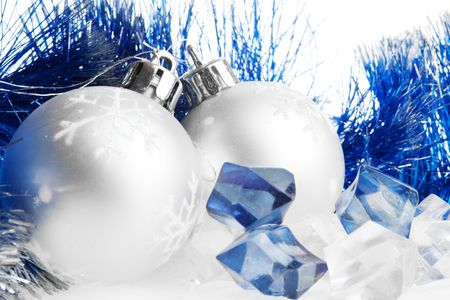 Two silver Christmas balls and several ice cubes Stock Photo - 5708909