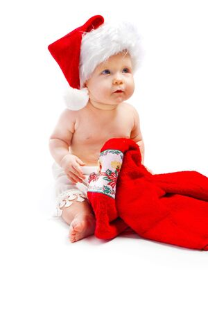 Lovely baby in santa hat with a red Christmas towe Stock Photo - 5706002