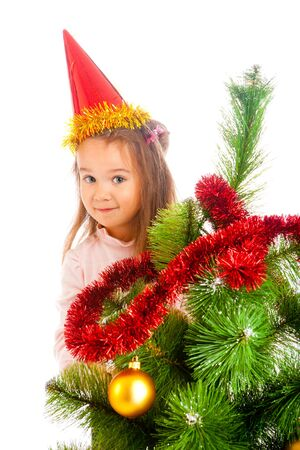 Lovely preschool girl decorating Christmas tree photo