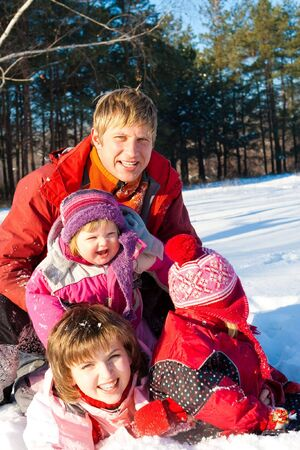 Happy family in a winter snowy park photo