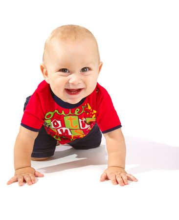 baby crawling: Laughing baby boy crawling, isolated