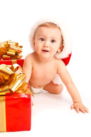 Baby boy with Christmas presents photo