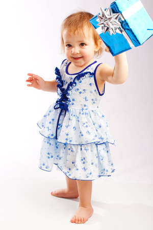 Lovely toddler holding a blue present box Stock Photo - 5781433