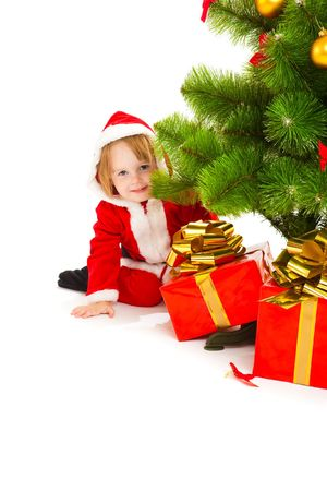 baby open present: Baby in a red santa costume opening a present box