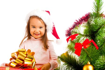 Lovely preschool girl holding  a large present box photo