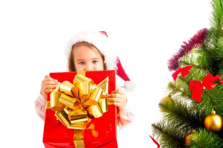 Lovely preschool girl giving a large present box photo