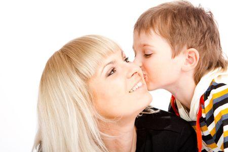 Portrait of a preschool boy kissing his mother photo