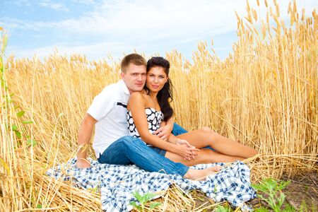 Happy couple enjoying summer weekend outside photo