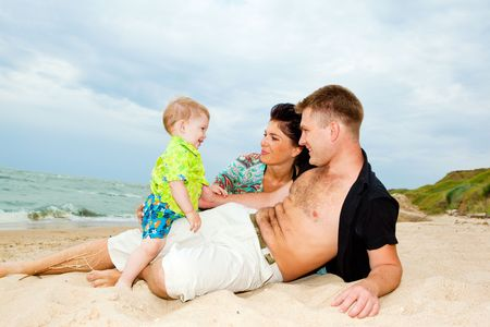 Happy kid talking to his parents at the beach Stock Photo - 5832366