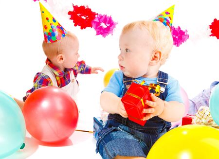 Babies playing at the birthday party Stock Photo