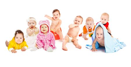 Group of cute happy children. Sitting, crawling or lying. photo