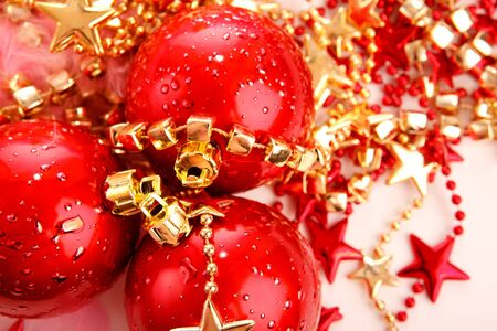 Three red christmas ball baubles on stars decoration isolated over white photo