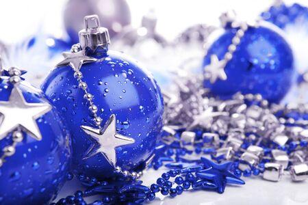 Three blue christmas ball on stars decoration over white photo