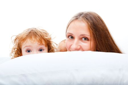 Beautiful mother and daughter lying on the pillow Stock Photo - 5880274