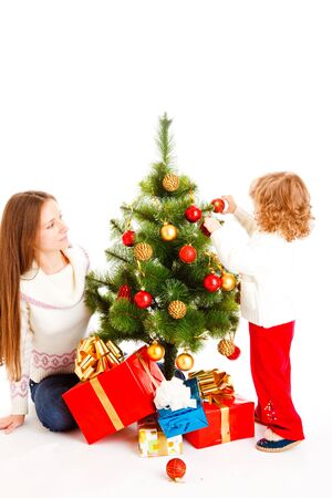 Mother and lovely daughter decorating Christmas tree photo