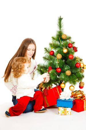 Mother and lovely daughter decorating Christmas tree Stock Photo - 5880469