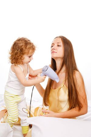 Pretty curly girl drying her mom's hair Stock Photo - 5880273