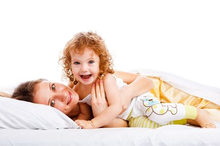 Beautiful mother and daughter lying on the pillow Stock Photo - 5880066