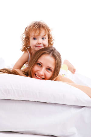 Beautiful mother and daughter lying on the pillow Stock Photo - 5880260