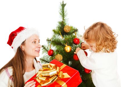 Mother and little daughter opening a present box Stock Photo - 5880275