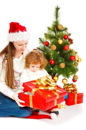 baby open present: Mother and little daughter opening Christmas present