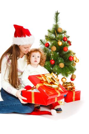 Mother and little daughter opening a present box photo