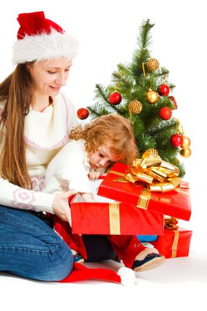 Mother and little daughter opening a present box Stock Photo - 5880459