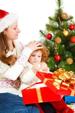 Mother and little daughter sit with Christmas presents photo