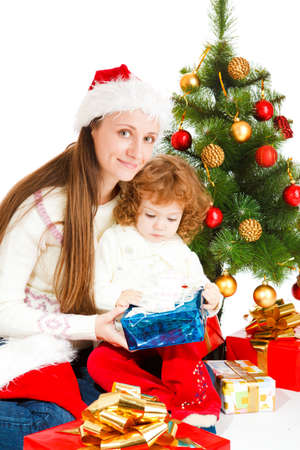 Mother and little daughter opening a present box Stock Photo - 5880484