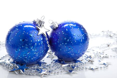 christmas embellishments: Blue christmas ball baubles with silver decoration, isolated Stock Photo
