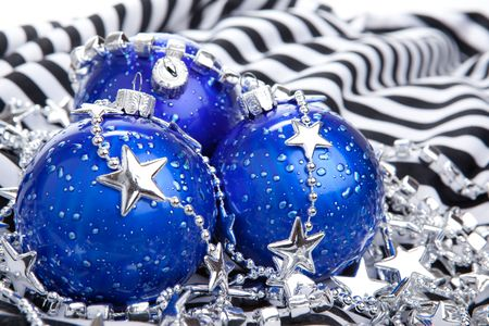 Blue christmas ball baubles on stripes background, isolated photo