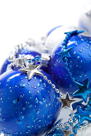 Blue Christmas baubles with silver decoration, isolated photo