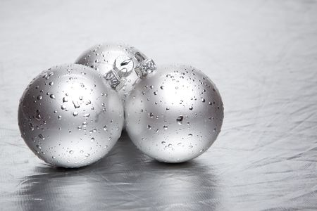 Christmas baubles on silver background photo