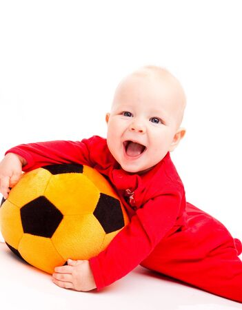 surprised child: Laughing baby with the soccer ball Stock Photo