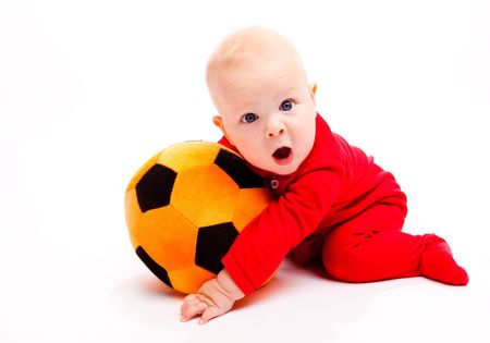 Surprised soccer baby with his mouth wide open photo