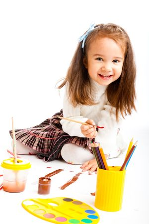 Preschool girl painting photo