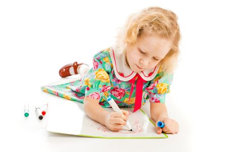 Cute blond preschool girl lying on floor and drawing photo