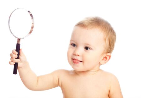 surprised baby: Clever baby with a magnifier glass Stock Photo