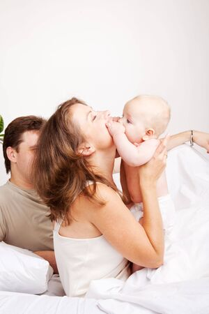 Lovely family morning in the bedroom Stock Photo - 6023596