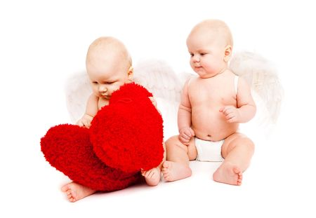 Two angelic baby friends playing with red hearts photo